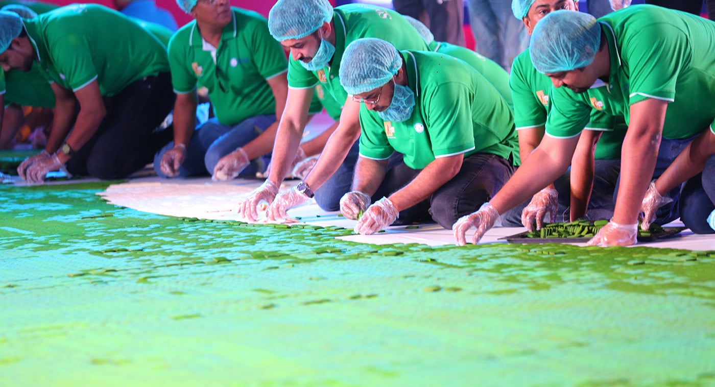 150,000 green and white Sooper cookies were laid out in the shape of Pakistan's flag.