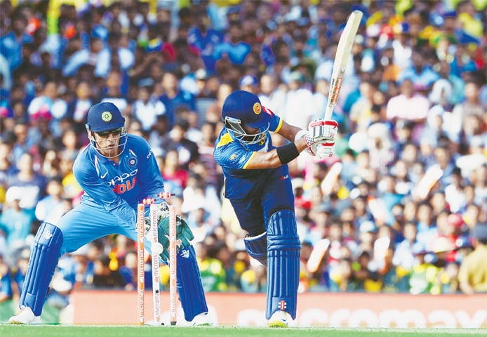 DAMBULLA Sri Lankan batsman Kusal Mendis is cleaned up by Indian spinner Axar Patel as wicket-keeper M.S. Dhoni looks on during the first One-day International at the Rangiri Dambulla International Cricket Stadium on Sunday.—AFP