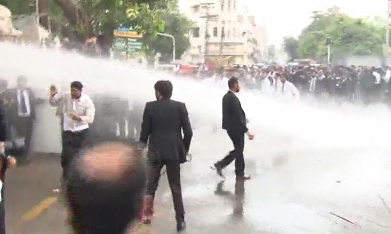 Police fire water cannon at protesting lawyers outside LHC.— DawnNews