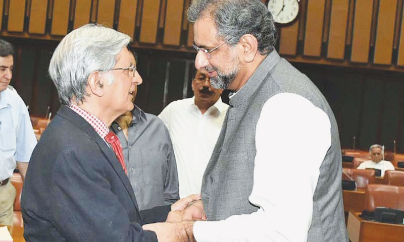 Prime Minister Shahid Khaqan Abbasi shakes hands with Leader of the Opposition Aitzaz Ahsan in the Senate on Monday.— APP