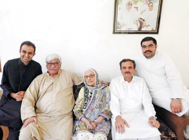 Asfandyar Wali with Begum Naseem Wali in Charsadda on Tuesday. — Dawn