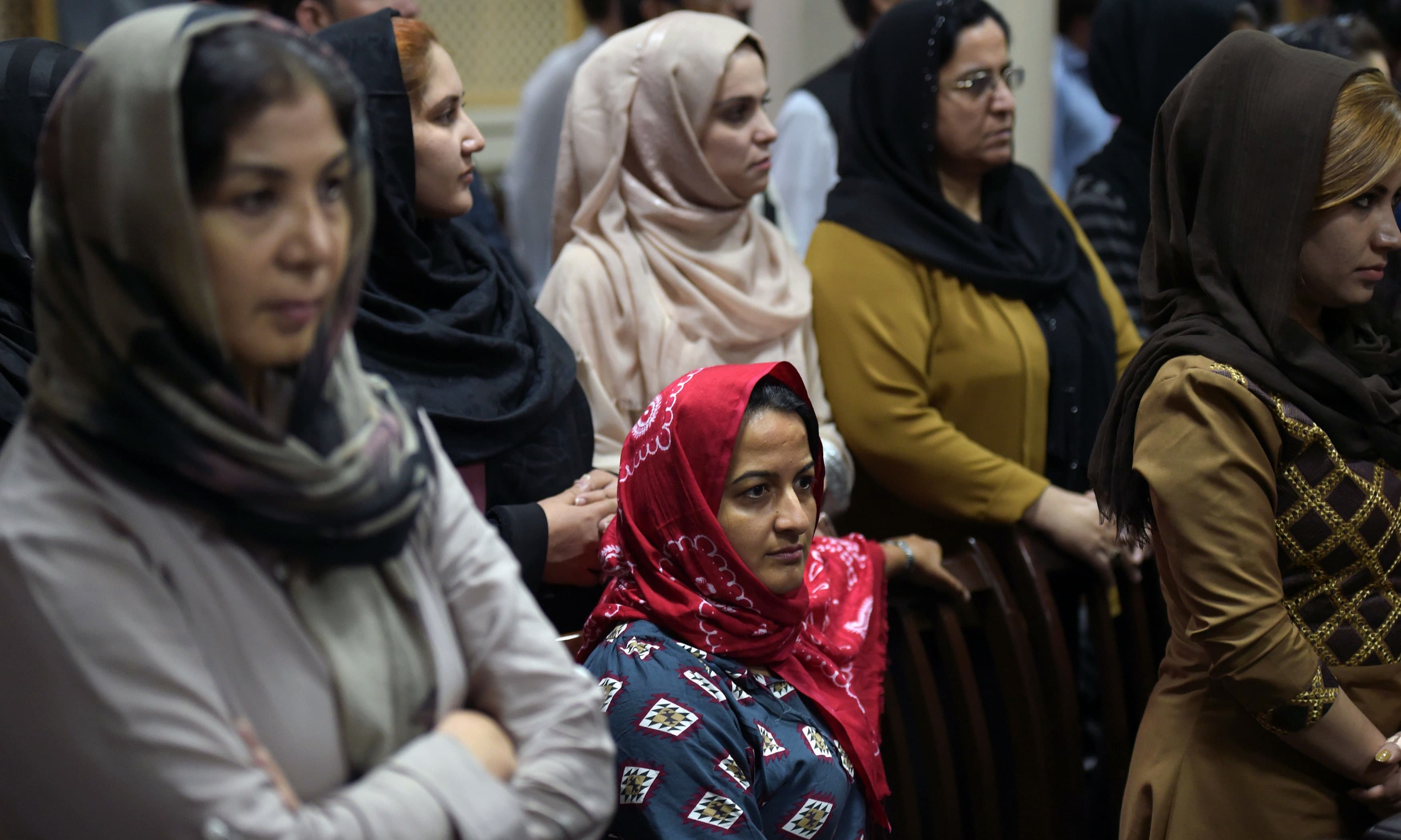 "Afghan women attend the first public event for the ""Where Is My Name"" campaign in Kabul. —AFP"