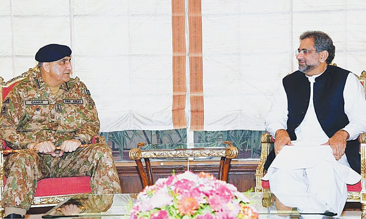General Qamar Javed Bajwa and Prime Minister Shahid Khaqan Abbasi at a meeting held earlier this month.—File