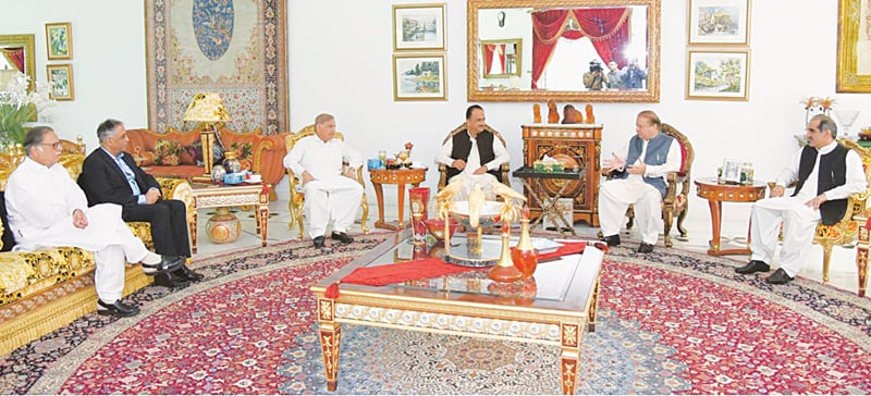Former prime minister Nawaz Sharif talks to Asad Junejo at Jati Umra in Raiwind on Thursday. Punjab Chief Minister Shahbaz Sharif, Sindh Governor Mohammad Zubair, Railways Minister Khawaja Saad Rafiq and former information minister Pervaiz Rashid are also present.—Online