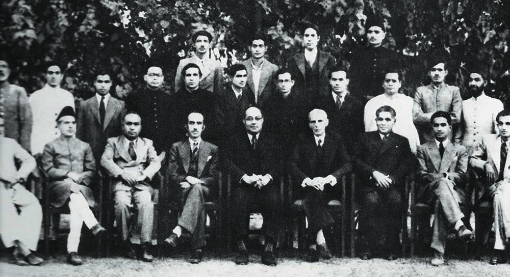 Quaid-i-Azam Mohammad Ali Jinnah, owner of Dawn Delhi, and Nawabzada Liaquat Ali Khan, Managing Director, with the newspaper's staff in the early 1940s. Seated second from right is Pothan Joseph, the Editor. — The Altaf Husain Collection