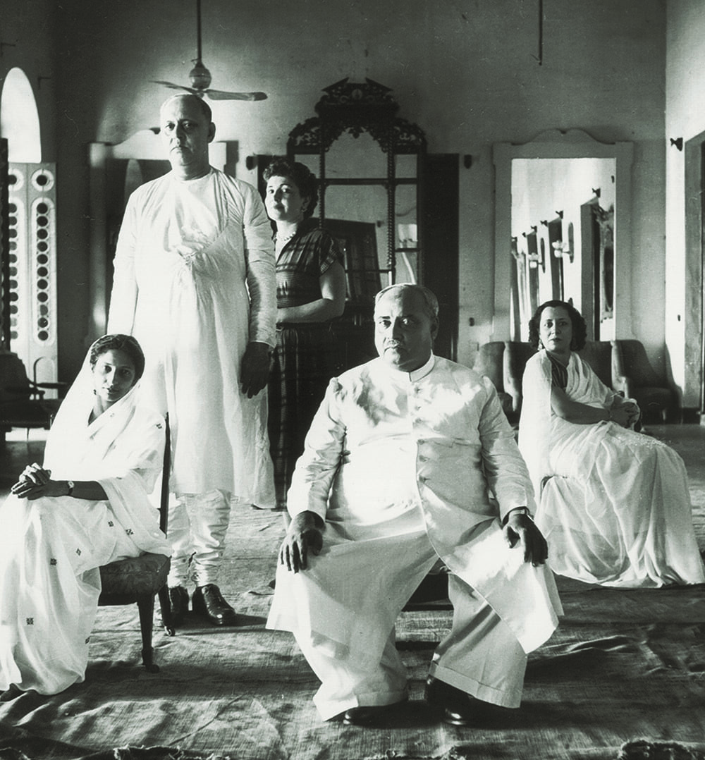 Khawaja Nazimuddin, the country's second Governor General who also was the second Prime Minister, seated here in an impressive room of Ahsan Manzil, the ancestral home of his cousin, the Nawab of Dhaka, Khawaja Habibullah Bahadur, who stands on the left with wife Ayesha Begum. Behind the Nawab is Allene Talmey Plaut, associate editor and columnist for Vogue. On the extreme right is Begum Najma Nooruddin, the sister-in-law of Khawaja Nazimuddin. This photograph was taken by Irving Penn in 1947 and was first published in Vogue. At the time, Khawaja Nazimuddin, who had been the Premier of Bengal in British India, was the Chief Minister of East Bengal. — The Nawab of Dhaka Archives, Karachi
