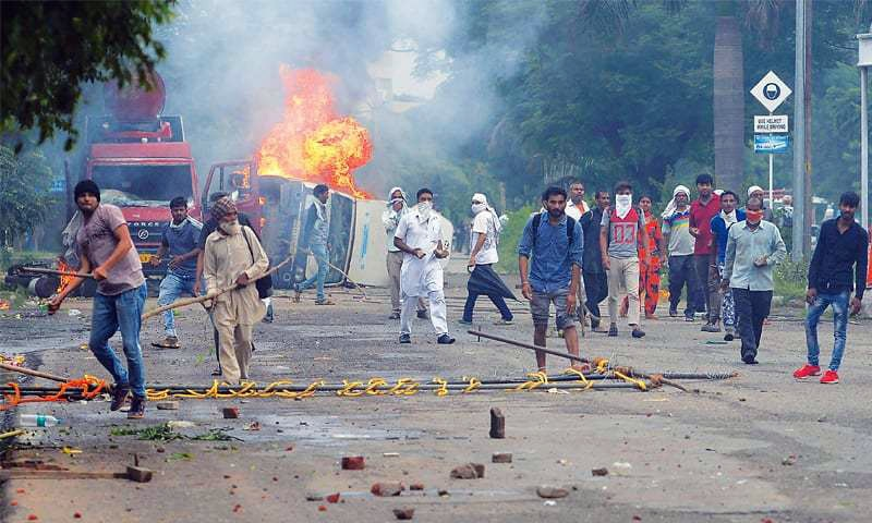 Clashes claim 32 lives in India as court convicts guru of