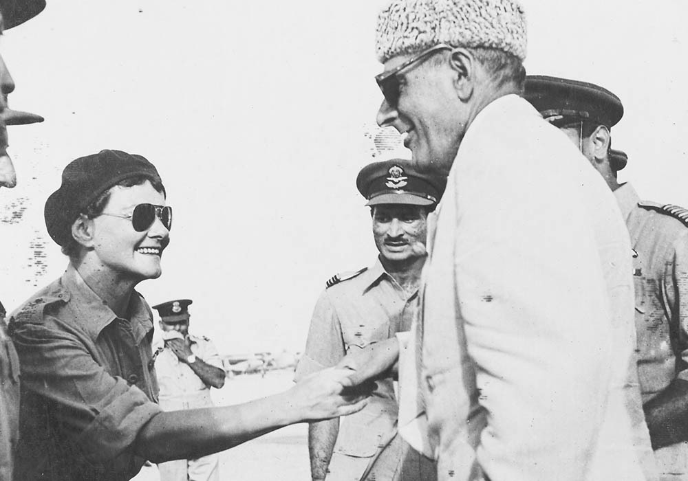 Sir Ghulam Mohammad shakes hands with Mrs. Hikulsiki, a glider instructor, when all the pilots who took part in the air display were introduced.— Courtesy The Malik Ghulam Mohammad Archives in the possession of Naeem Malik, Karachi.