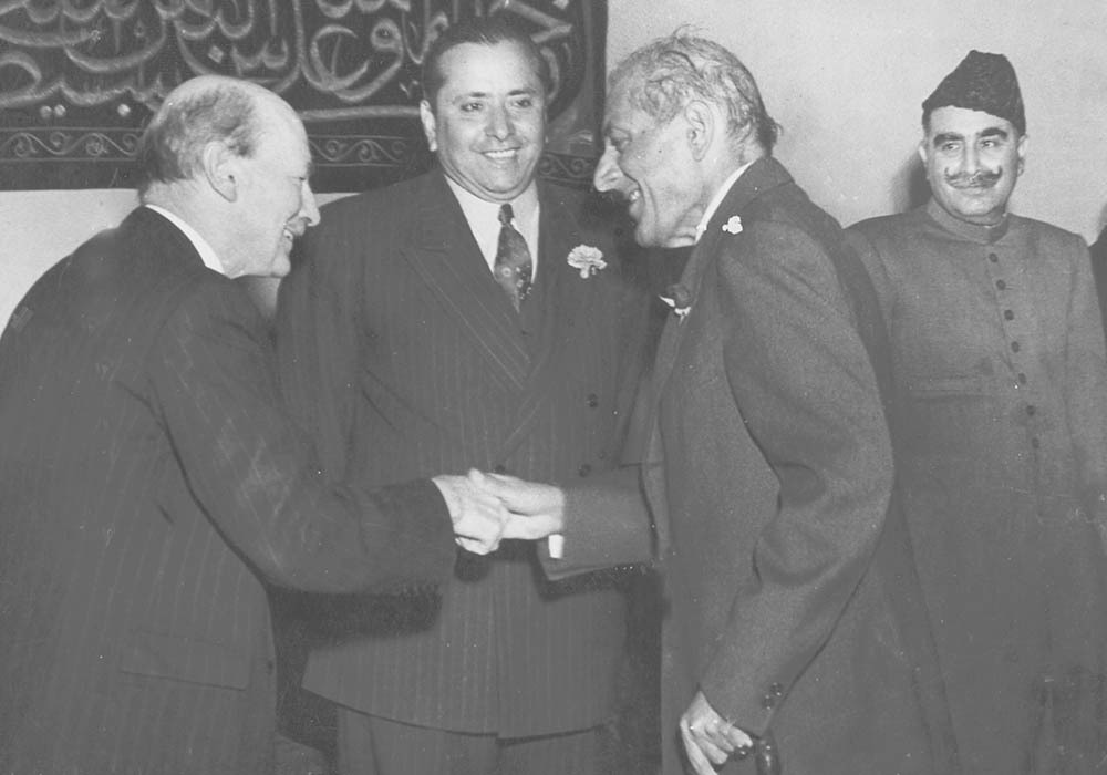 Sir Ghulam Mohammad shaking hands with Mr. Clement Attlee, the British Prime Minister. — Courtesy The Malik Ghulam Mohammad Archives in the possession of Naeem Malik, Karachi.