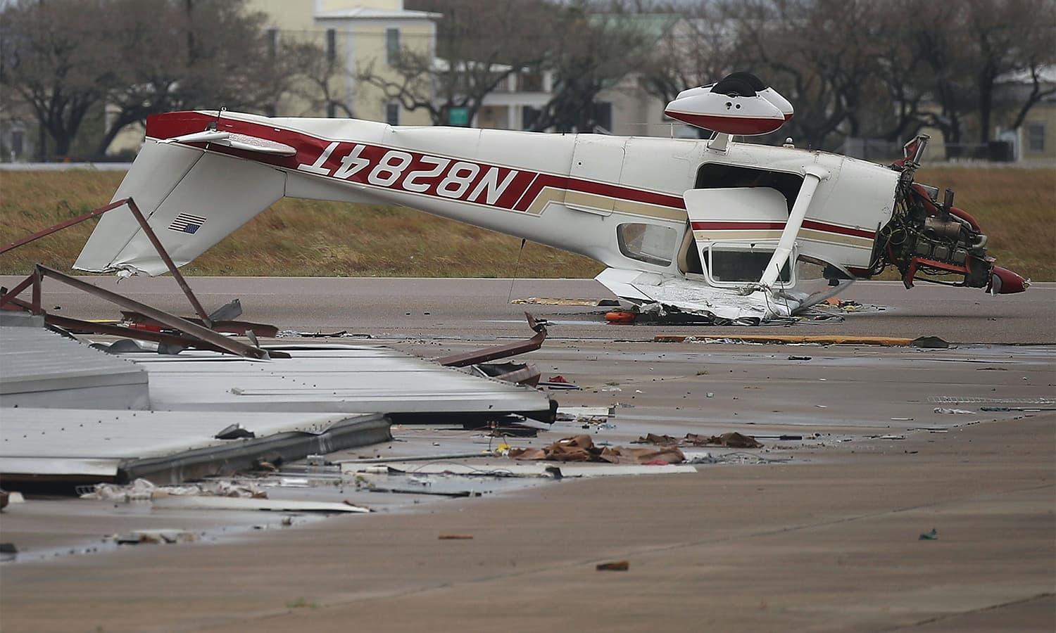 An airplane is seen flipped on its roof at the Aransas County Airport after Hurricane Harvey passed through. — AFP