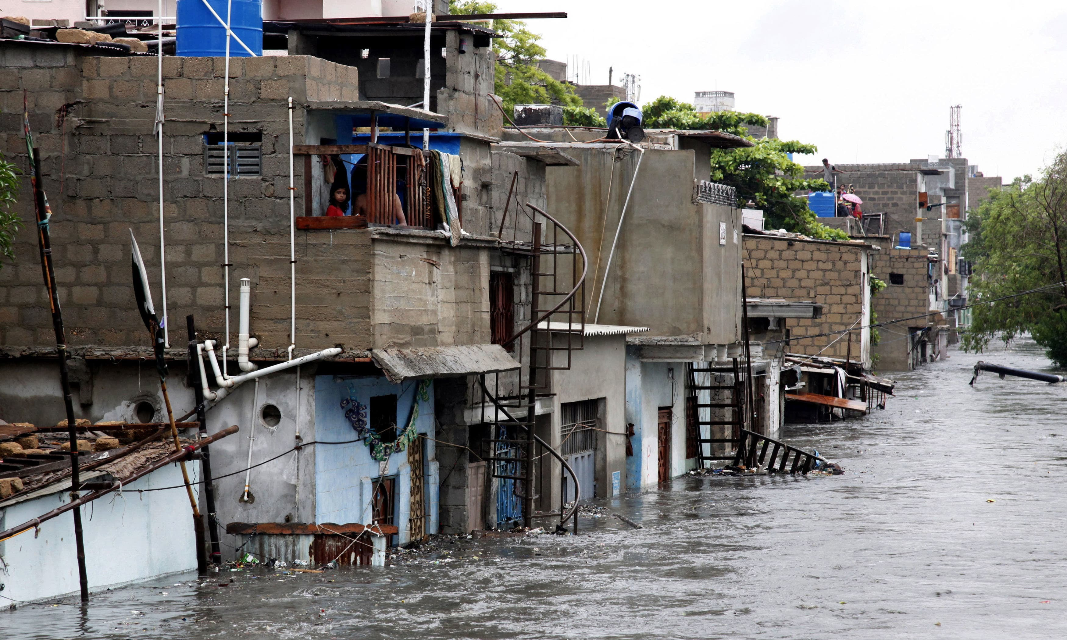 Houses are partially submerged following heavy rainfall in Karachi. ─ AP