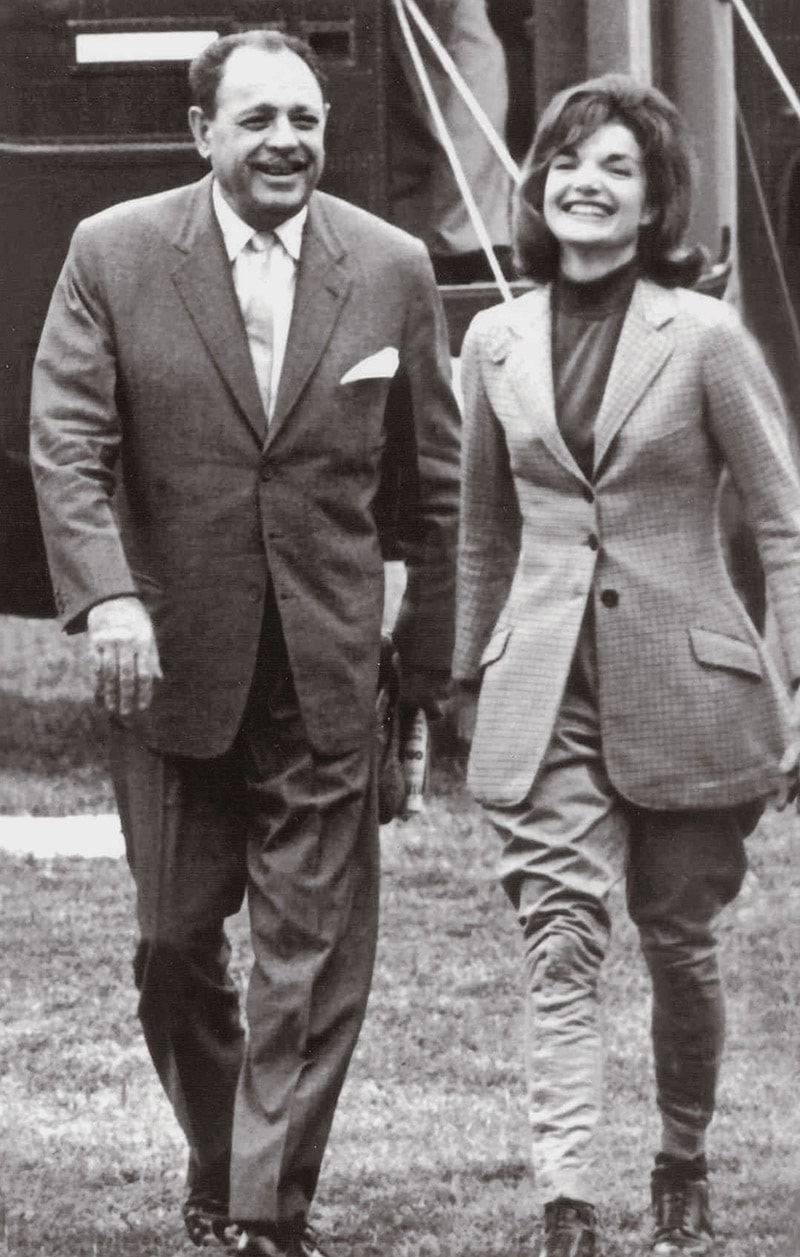 President Ayub Khan and US First Lady Jacqueline Kennedy smiling as they disembarked from a helicopter in Washington DC, after a trip to the Kennedy country estate in Middleburg, Virginia, on September 27, 1962. — Photo: The Adnan Aurangzeb Collection