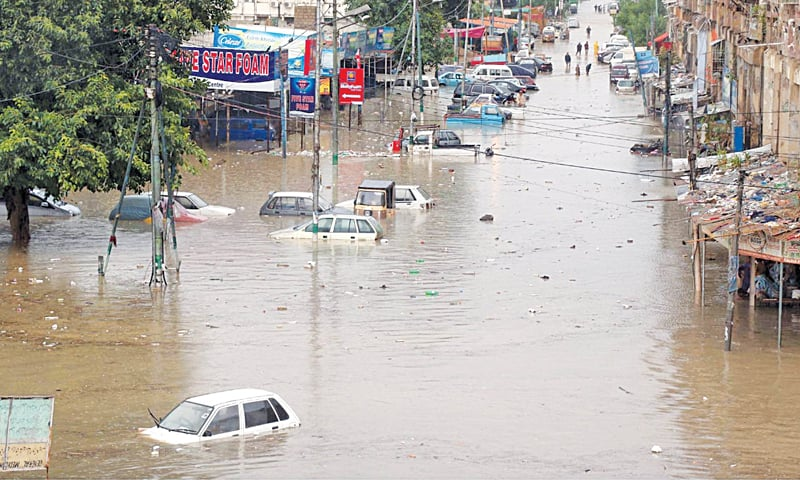 KARACHI: Vehicles stuck in floodwater after a downpour in the city on Thursday. The city government sought Pakistan Army's assistance to cope with the situation caused by the heavy rain. At least 23 people died in rain-related incidents.—Online