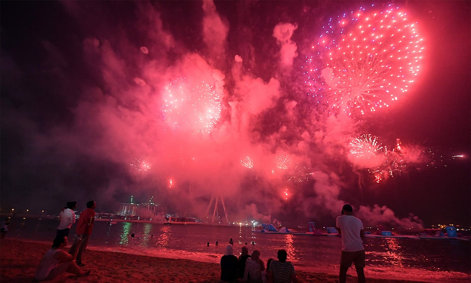 People watch fireworks in Dubai on August 31, 2017 on the eve of Eidul Azha.—AFP