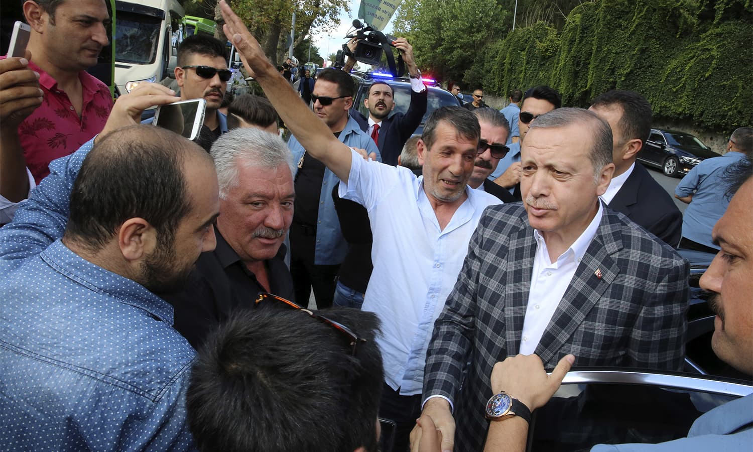 Turkey's President Recep Tayyip Erdogan, right, talks to supporters following Eid prayers in Istanbul.—AP