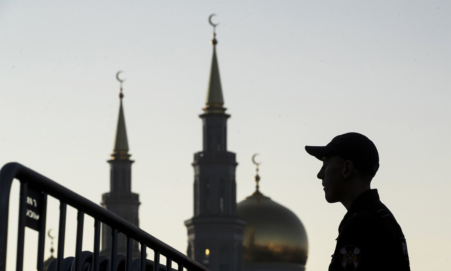 A police officer stands guard outside the Moscow Cathedral Mosque during celebrations of Eidul Azha, which Muslims in Russia call Kurban-Bairam, in Moscow, Russia.—AP
