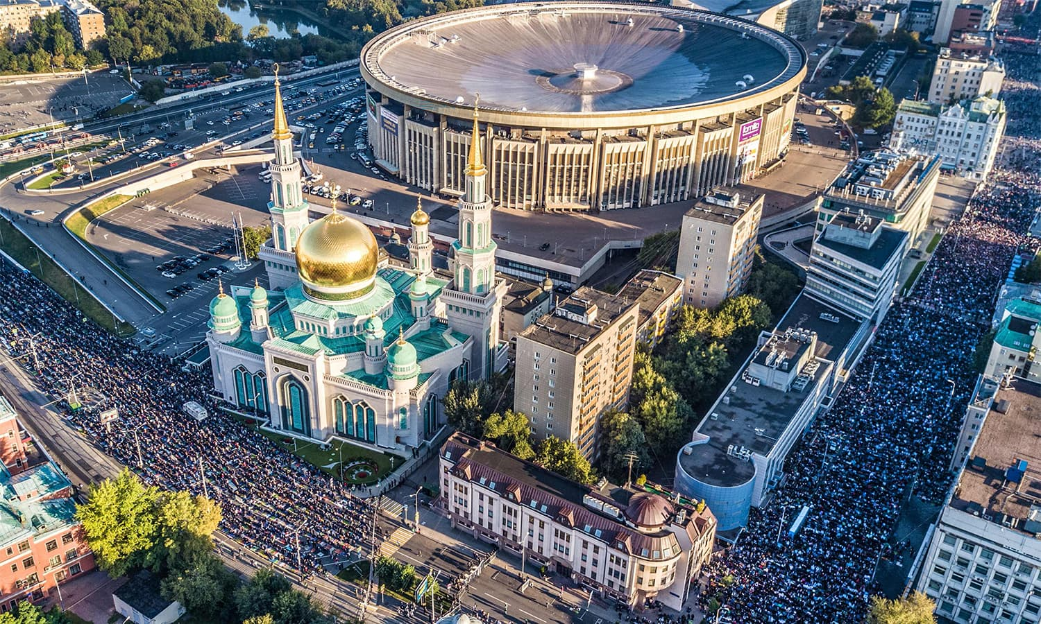 An aerial view taken with a drone shows members of Russia's Muslim community praying in a street outside the Central Mosque during Eidul Azha.—AFP