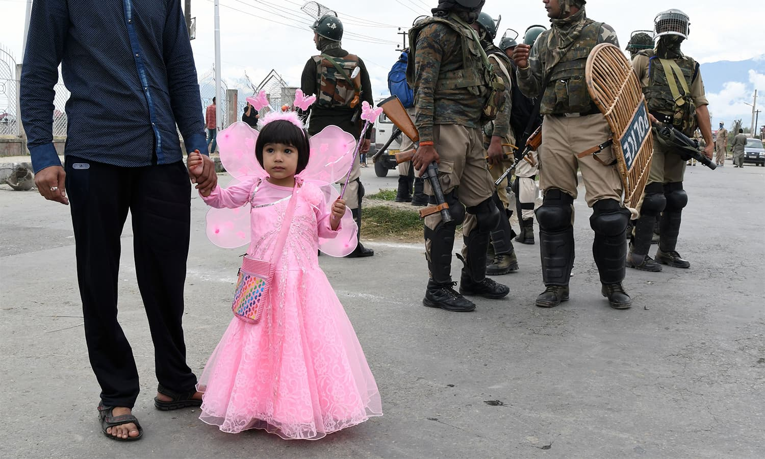 A young girl in Srinagar, India-held Kashmir looks on.—AFP