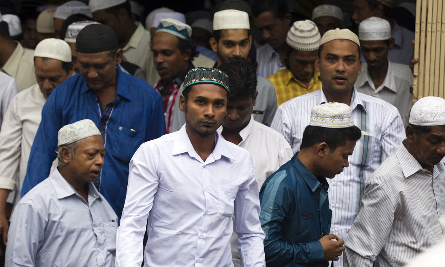 Muslims leave a mosque after offering Eid prayers in Yangon, Myanmar.—AP