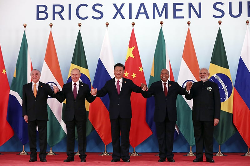 From left, Brazil's President Michel Temer, Russian President Vladimir Putin, Chinese President Xi Jinping, South Africa's President Jacob Zuma and Indian Prime Minister Narendra Modi pose for a group photo during the BRICS Summit at the Xiamen International Conference and Exhibition Center in Xiamen, southeastern China's Fujian Province on Monday.— AP