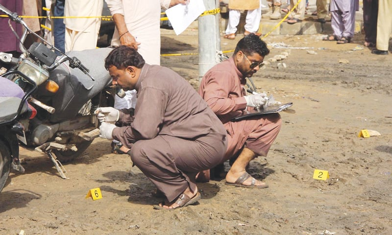 KARACHI: Security officials inspect the scene where gunmen attempted to assassinate Khwaja Izhar-ul-Hasan, Muttahida Qaumi Movement-Pakistan leader and the Leader of Opposition in the Sindh Assembly, in the Buffer Zone area.—Online