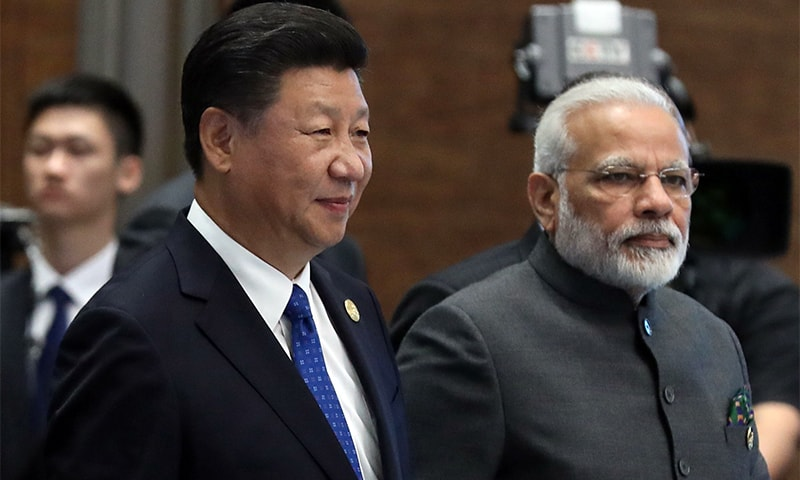 (L to R) Chinese President Xi Jinping and Indian Prime Minister Narendra Modi attend the Dialogue of Emerging Market and Developing Countries on the sidelines of the 2017 BRICS Summit in Xiamen, China's Fujian Province.—AFP