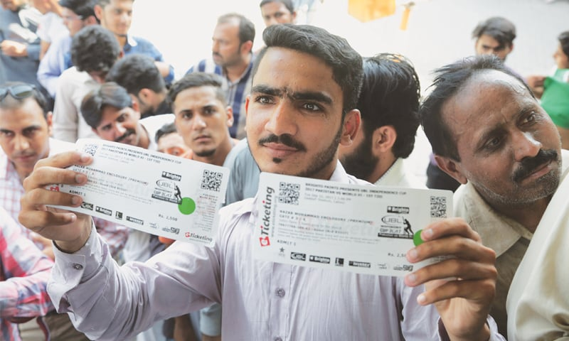 LAHORE: A cricket fan on Thursday shows off match tickets bought for the upcoming World XI series to be played at Gaddafi Stadium from Sept 12. The three-match T20 series, dubbed as the Independence Cup, is aimed at reviving international cricket in Pakistan after a period of eight and a half years since the 2009 terrorist attack on the Sri Lanka cricket team bus in Lahore. The World XI, led by South Africa's Faf du Plessis, comprises players from seven countries.—AP