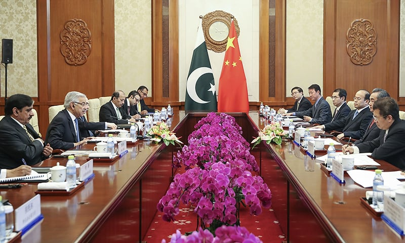 Chinese Foreign Minister Wang Yi, second right, meets with Foreign Minister Khawaja Asif at Diaoyutai State Guesthouse in Beijing.— AP
