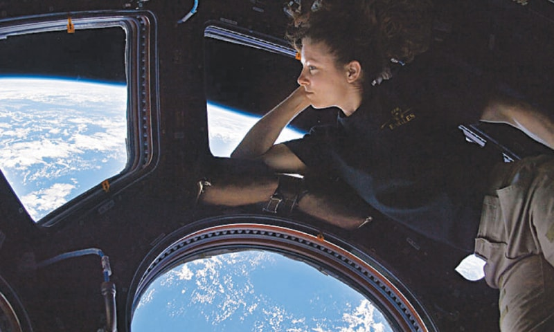 Tracy Caldwell Dyson in Cupola ISS enjoying the view / Photos courtesy: Nasa/ ESA