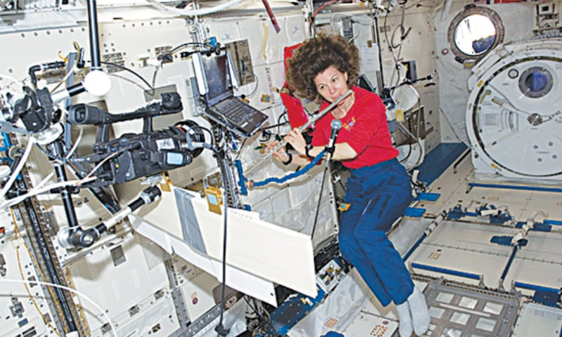 Astronaut Cady Coleman, Expedition 27 flight engineer, plays a flute in the JAXA Kibo laboratory onboard the International Space Station / Photos courtesy: Nasa/ ESA