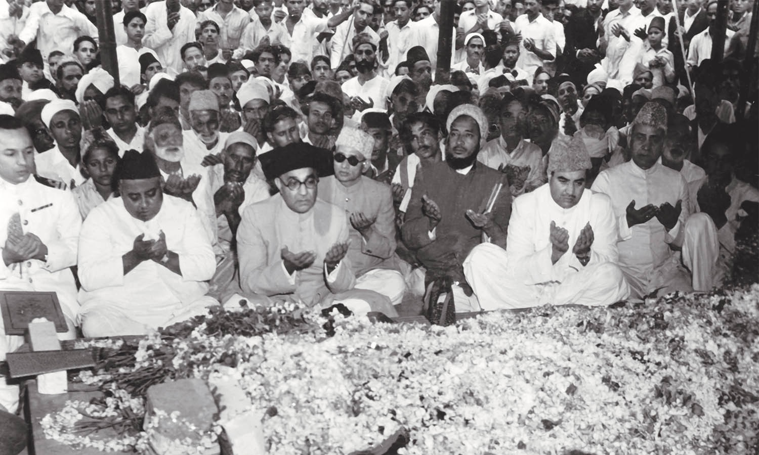 From left to right: Khawaja Nazimuddin, Nawabzada Liaquat Ali Khan and Yusuf Haroon are seen offering prayers at the gravesite of Quaid-i-Azam Mohammad Ali Jinnah. | Photo: The Press Information Department, Ministry of Information, Broadcasting & National Heritage, Islamabad (PID)