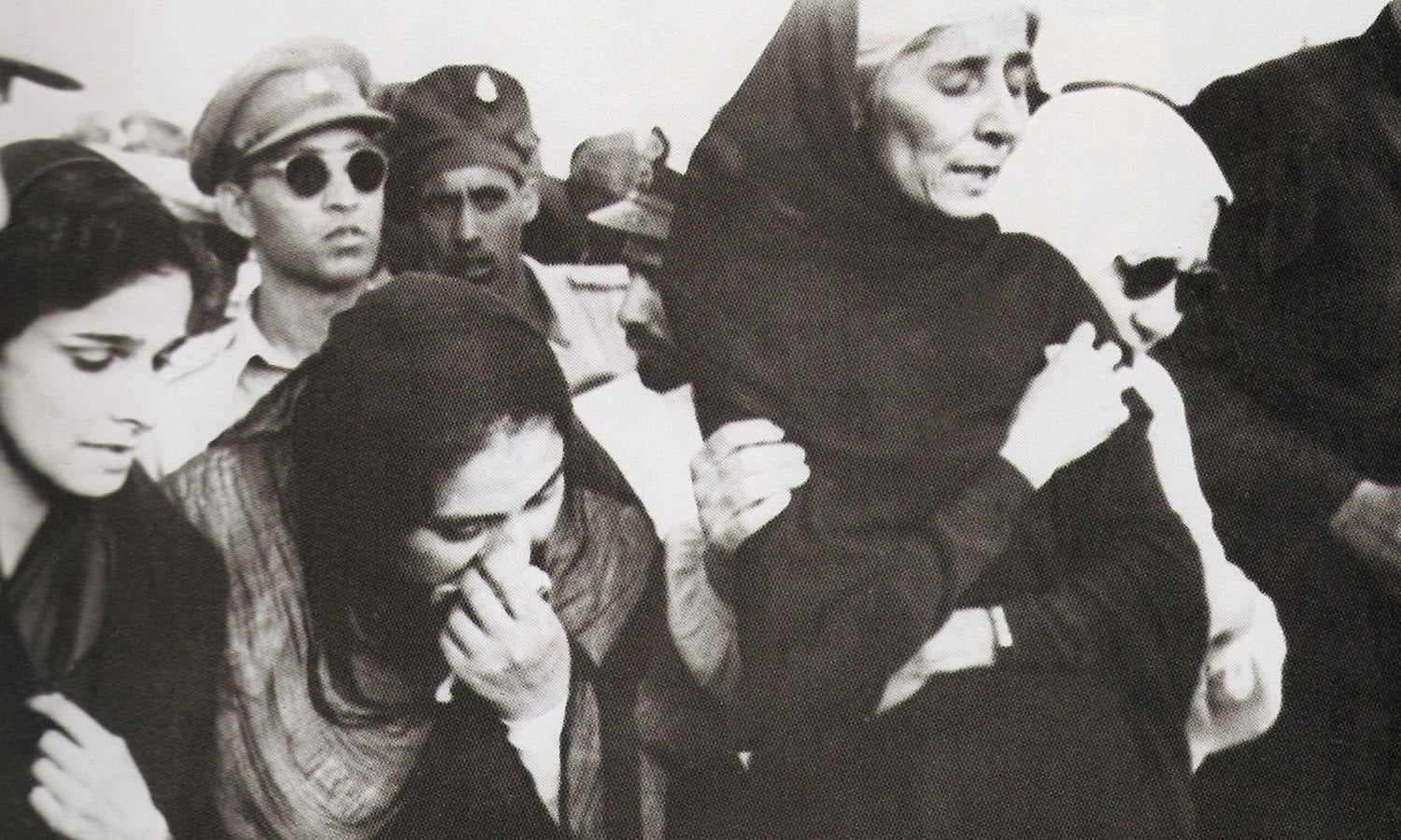 Dina Wadia (extreme left), Quaid-i-Azam Mohammad Ali Jinnah's only daughter, flew in from Delhi to attend her father's funeral. Seen on her left are Lady Ghulam Hussain Hidayatullah, Miss Fatima Jinnah, and Lady Nusrat Haroon. All were clearly and understandably unable to hold back their tears as they grieved Quaid-i-Azam Jinnah's death. | Photo: The Press Information Department, Ministry of Information, Broadcasting & National Heritage, Islamabad (PID)