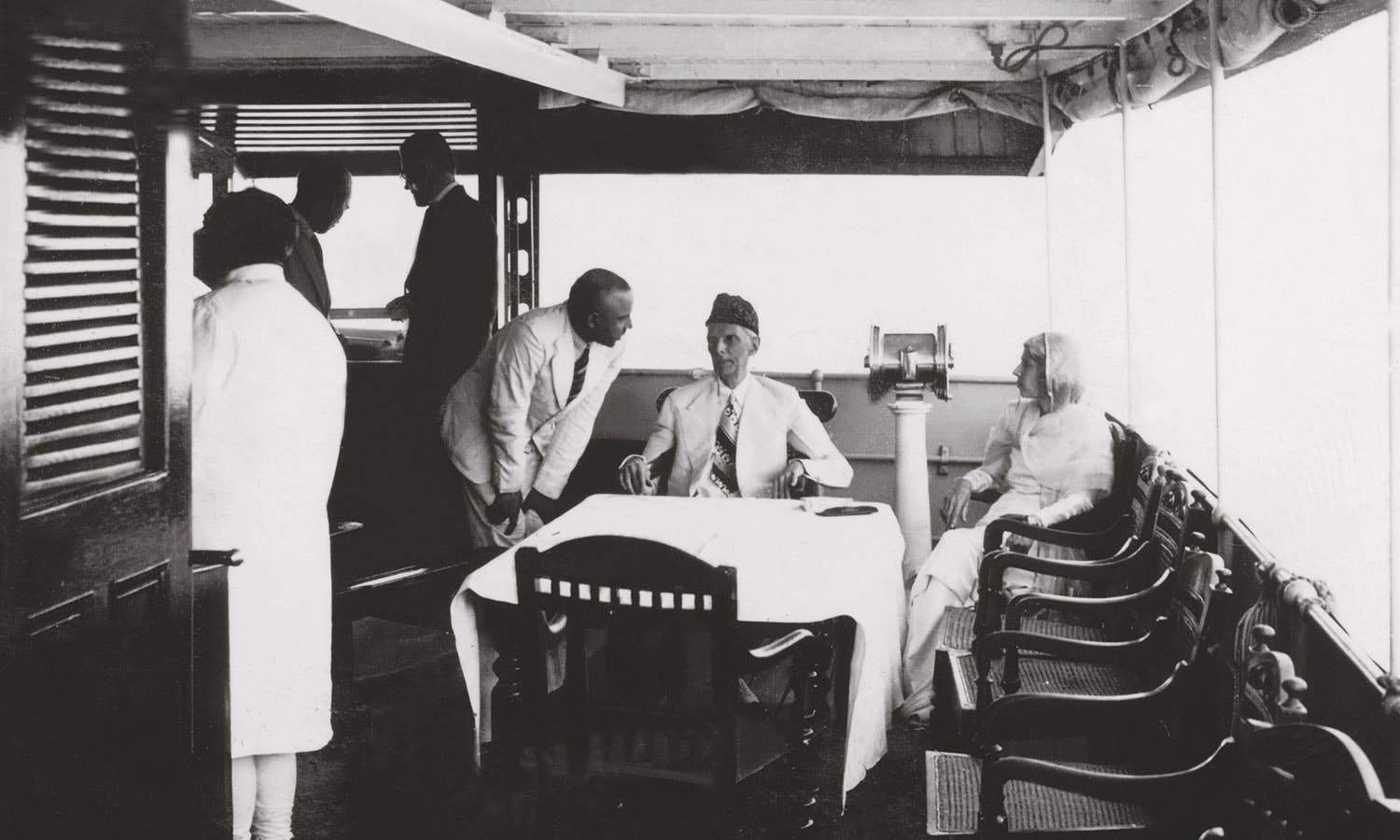 Quaid-i-Azam Mohammad Ali Jinnah and Miss Fatima Jinnah enjoying a boat ride, possibly in Dhaka, in the early 1940s. Standing on the left [wearing sherwani] is Khawaja Nazimuddin, who was at the time the Premier of Bengal. | Photo: The Press Information Department, Ministry of Information, Broadcasting & National Heritage, Islamabad (PID)