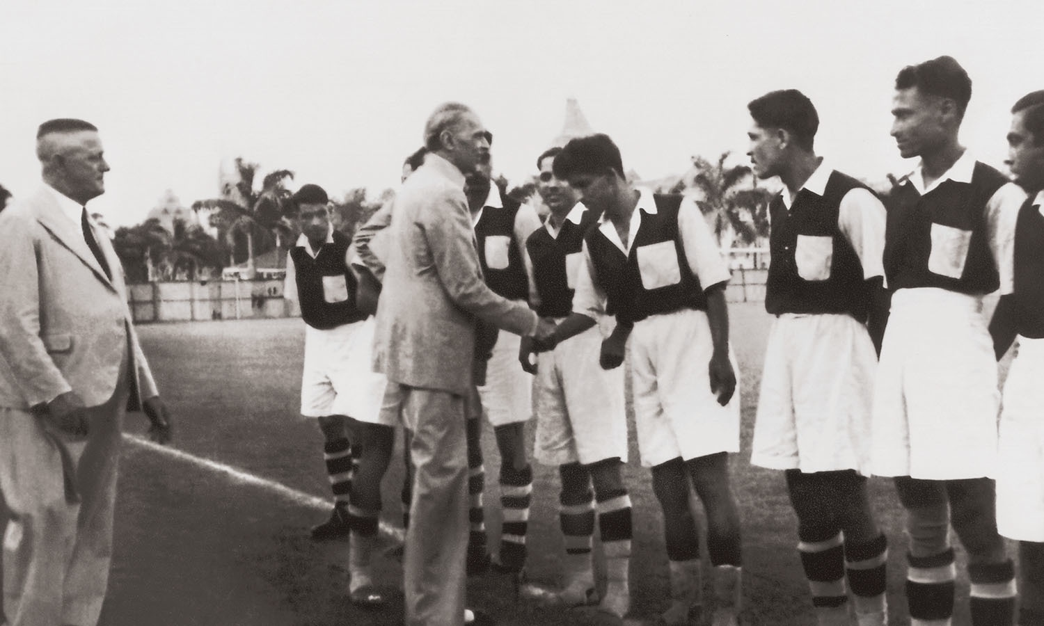 Quaid-i-Azam Mohammad Ali Jinnah always encouraged teamwork. He is seen here shaking hands with members of the Mohammadan Sporting Club in Calcutta, possibly in the late 1930s. Due to paucity of funds, the players could not afford shoes, and, therefore, played without them. Yet they managed to win several matches against British and Hindu teams. Khawaja Nazimuddin, Premier of Bengal in British India and Chief Minister of East Bengal post-partition, served as the Club's president from 1936 to 1940. | Photo: The Private Collection of Shahnaz Babar Khairuddin
