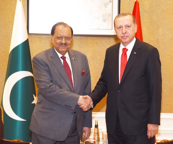 ASTANA: President Mamnoon Hussain shakes hands with Turkish President Recep Tayyip Erdogan prior to their meeting on the sidelines of the first summit of the OIC on science and technology on Saturday.—APP