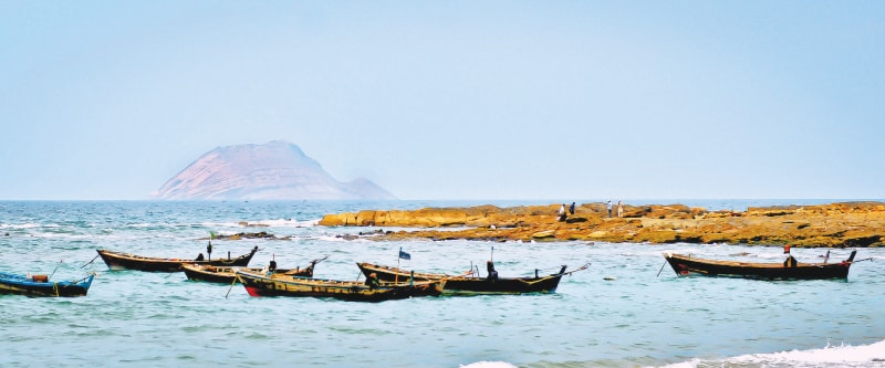 Churna Island is seen in the distance while fishing boats are out for the catch of the day | Fahim Siddiqi / White Star