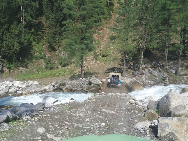 Crossing a stream in a jeep