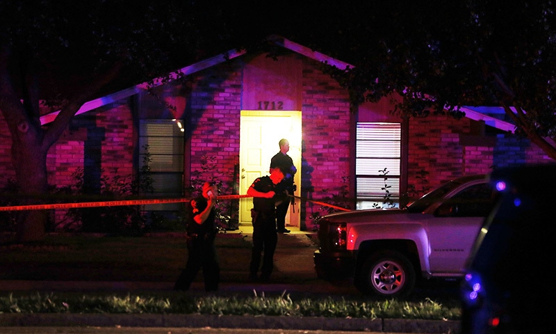 Police officers work at the scene of a shooting at a home in Plano, north of Dallas, Texas.—AP