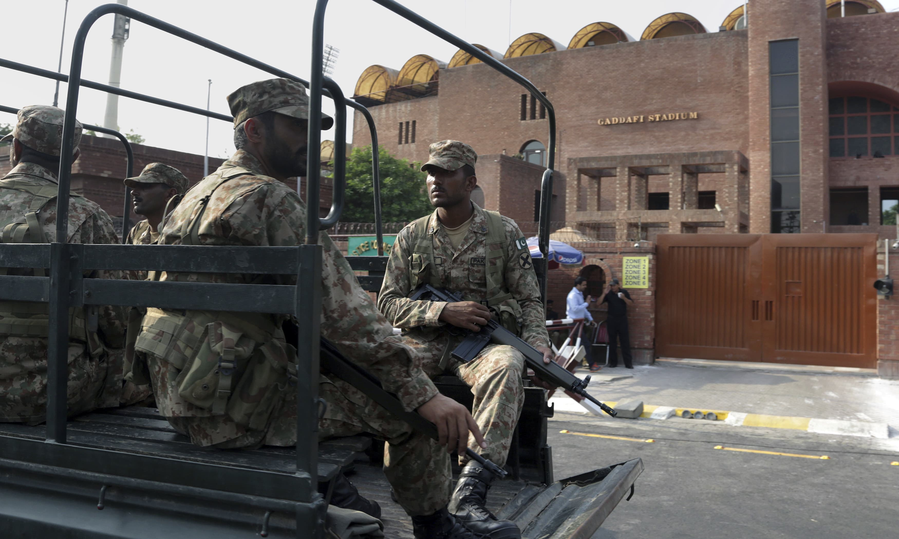 Troops stand guard outside the Gaddafi stadium. —AP