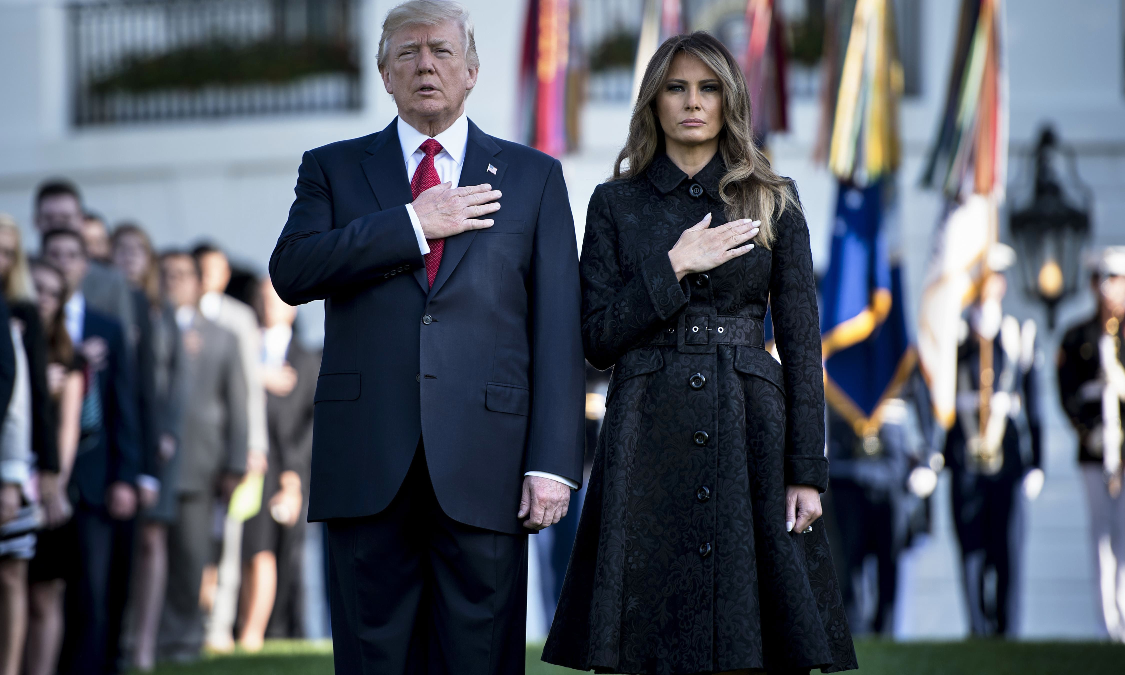 US President Donald Trump and First Lady Melania Trump observe a moment of silence on September 11, 2017 at the White House. —AFP