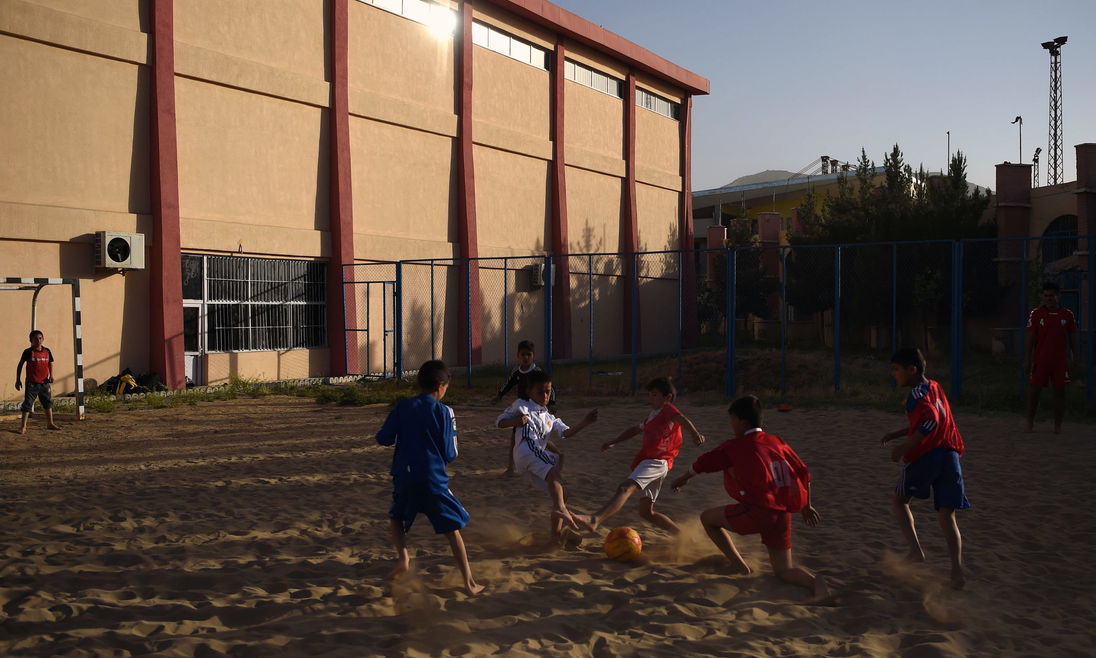 Almost 200 boys, many from extremely poor families, train around three times a week at the Ghazi stadium. —AFP