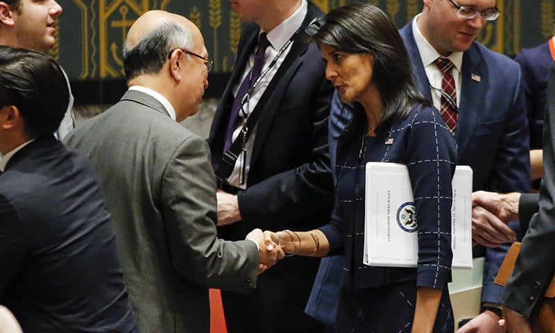US Ambassador to the UN Nikki Haley speaks with Japan's UN Ambassador Koro Bessho.— AFP