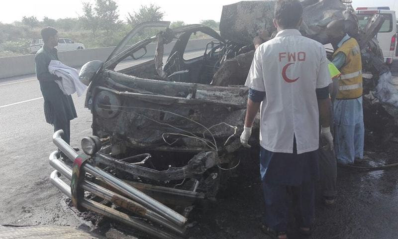 The Rawalpindi-bound Hiace van caught fire after crashing into a trailer from behind. —DawnNews