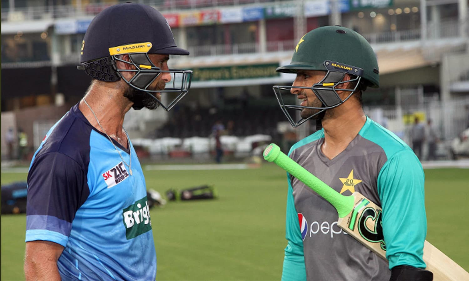 New Zealand's Grant Elliott (L) chats with Pakistani all-rounder Shoaib Malik.— Photo courtesy: PCB Twitter @TheRealPCB