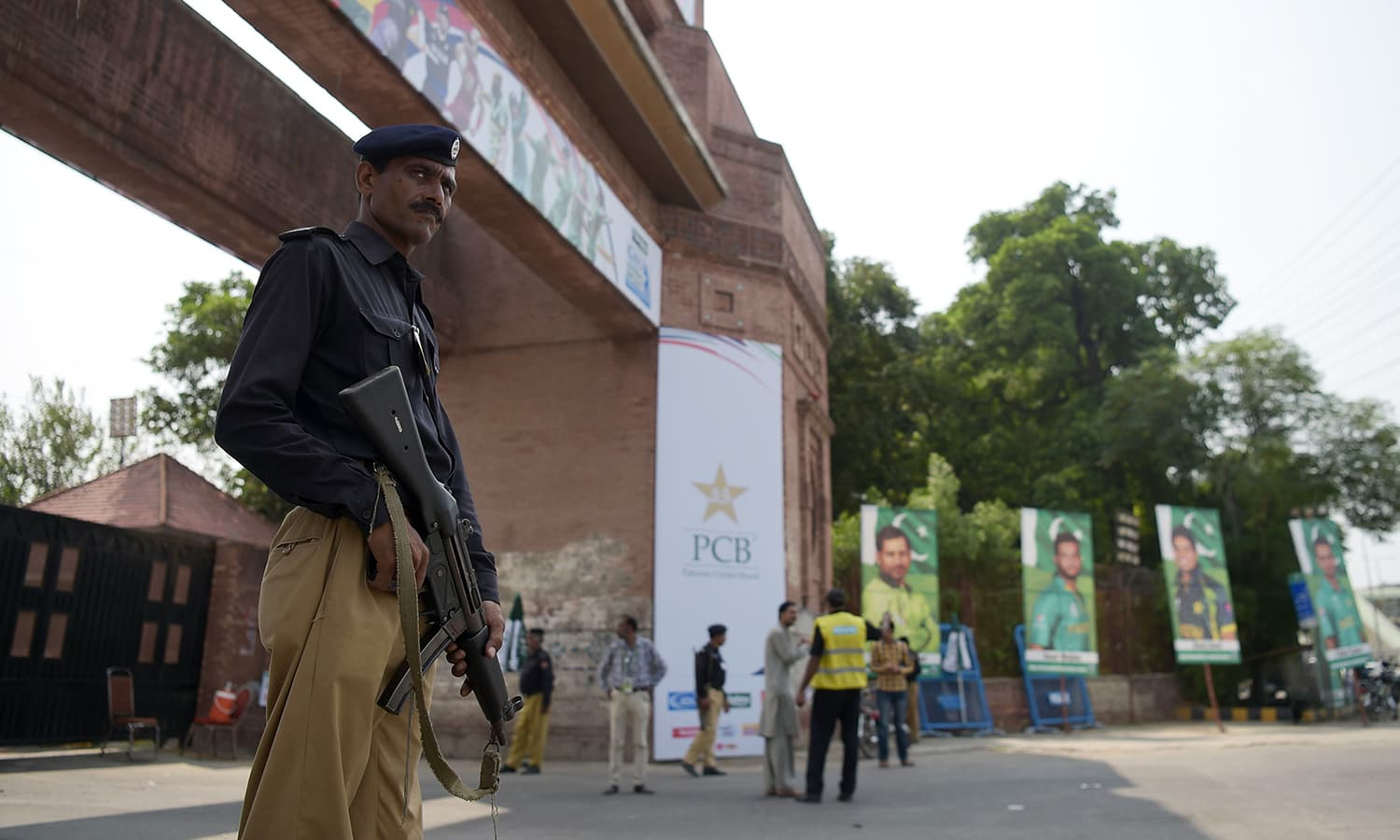 A policeman stands guard at the main entrance of the Gaddafi Cricket stadium in Lahore on September 12. — AFP