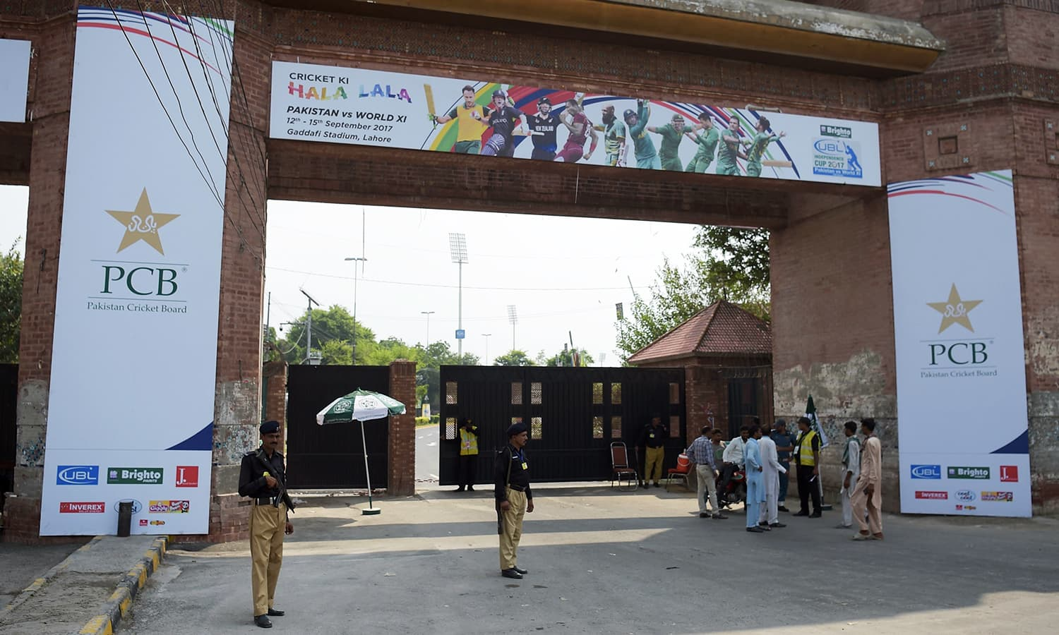 Policemen stand guard at the main entrance of the Gaddafi Cricket stadium on September 12.— AFP