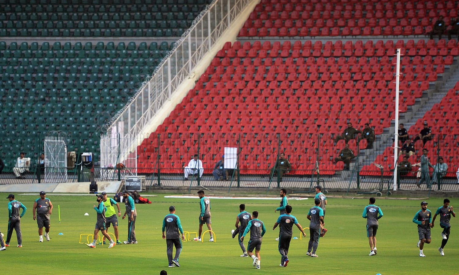 Pakistani cricketers exercise during a practice session at the Gaddafi Stadium on September 11.— AFP