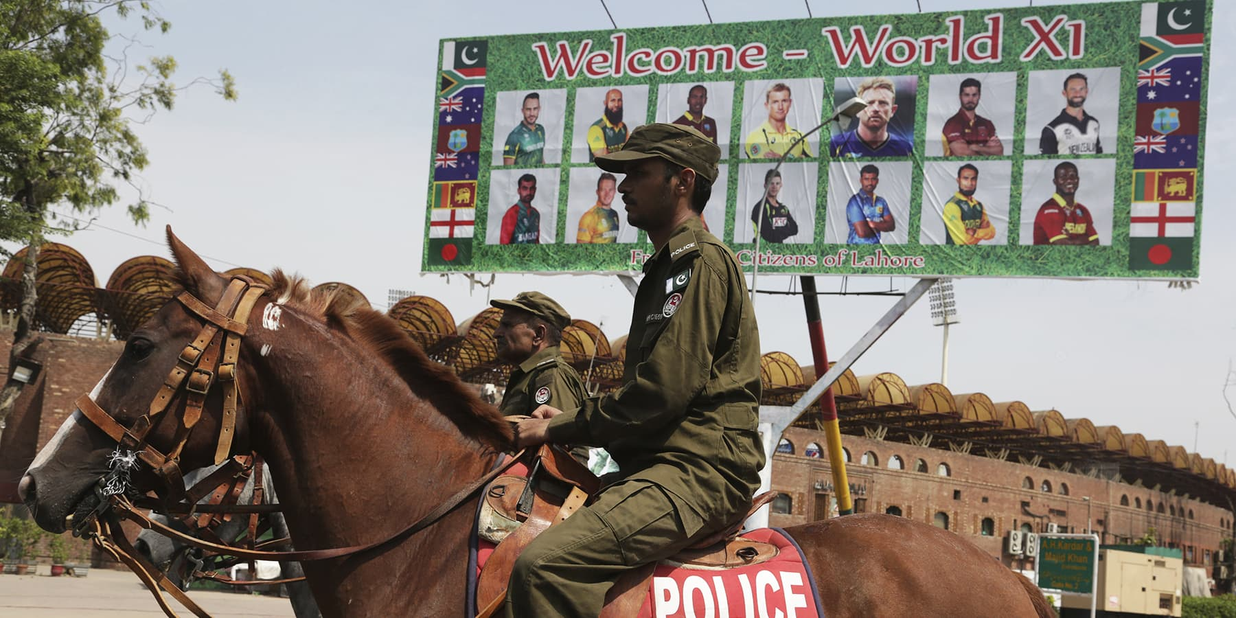 Pakistani police officers patrol in the vicinity of Gaddafi Stadium ahead of the World XI cricket series, in Lahore, Pakistan, Monday, Sept. 11, 2017. The series is aimed at reviving international cricket in Pakistan, since terrorists attacked the Sri Lanka cricket team bus in Lahore in 2009. (AP Photo/K.M. Chaudary) — Copyright 2017 The Associated Press. All rights reserved.