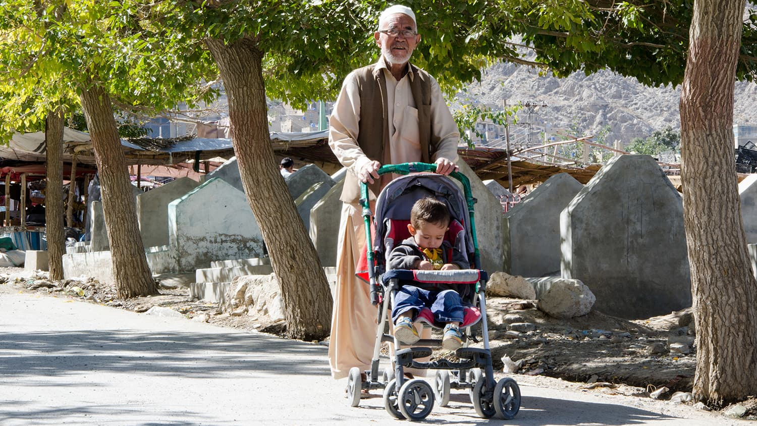 An old man out with his grandson for some fresh air.
