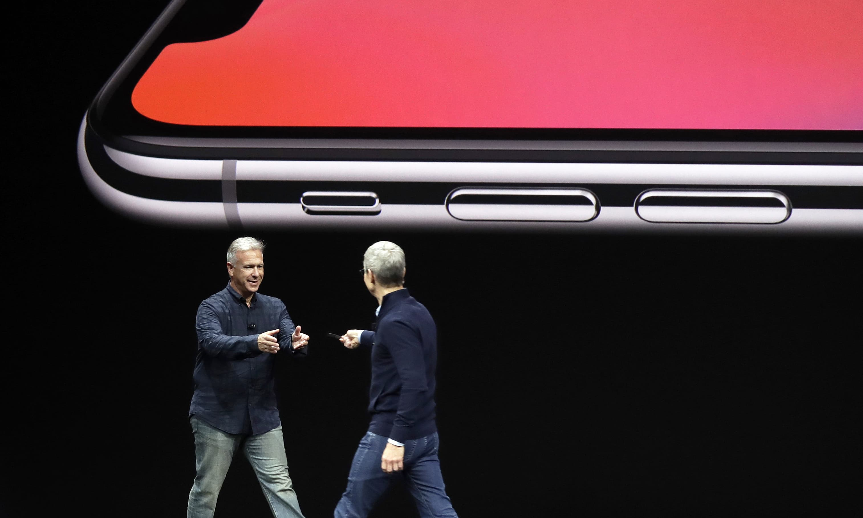Phil Schiller, Apple's senior vice president of worldwide marketing, left, takes over from CEO Tim Cook as they discuss the features of the new iPhone X at the Steve Jobs Theater. —AP